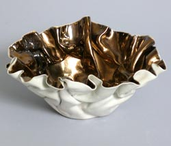 white and gold bowl